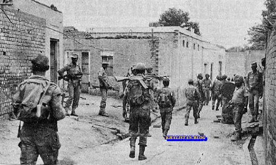 CRPF Platoon marching through a village